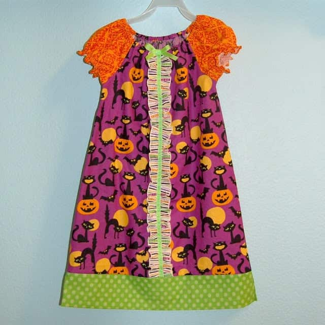 Sew your own Halloween Peasant Dress with your favorite pattern or use my free peasant dress pattern!  (Free peasant dress pattern comes in sizes 12 mo to 14 yrs.)