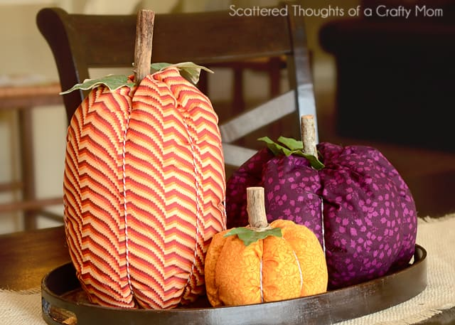 Learn how to make a quick and easy Fabric Pumpkin. These Colorful Fabric Pumpkins are so simple to make - this tutorial demonstrates either with hand sewing and glue or by machine!
