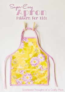 Easy Child's Apron Pattern and Tutorial: Get the free pattern and tutorial to make this super easy child's apron. (perfect to use up fabric scraps)