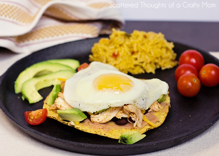 Chicken, bean, avocado tostada with fried egg on top