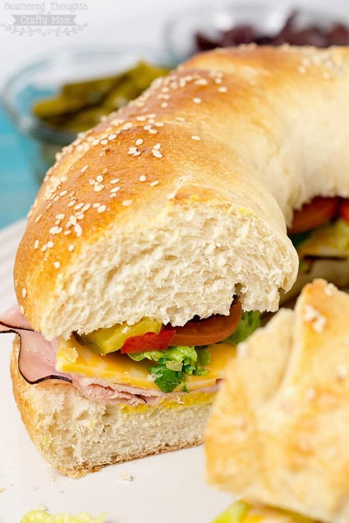 Spicy, mild, greek inspired- this DIY Sub Sandwich Ring is fabulous any way you like it. (Plus the ring sub sandwich presentation is always a crowd pleaser!) Perfect for game day or any other get together.