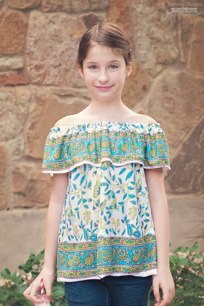 This Off-Shoulder Ruffle Top, is a free printable sewing pattern in sizes 3 to 12 and will definitely be a hit with your little fashionista!