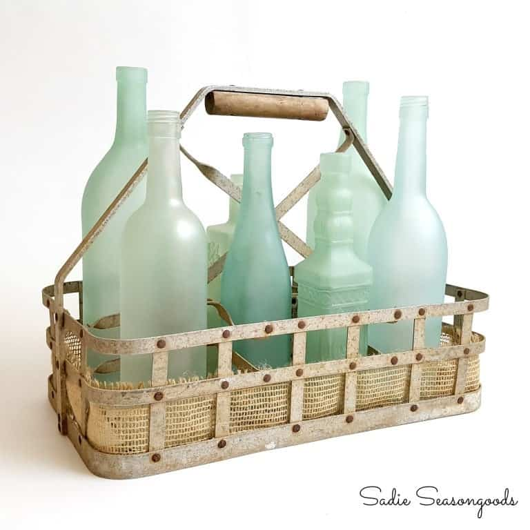 8_vintage_milk_bottle_carrier_basket_repurposed_as_coastal_beach_decor_centerpiece_with_diy_sea_glass_bottles_sadie_seasongoods
