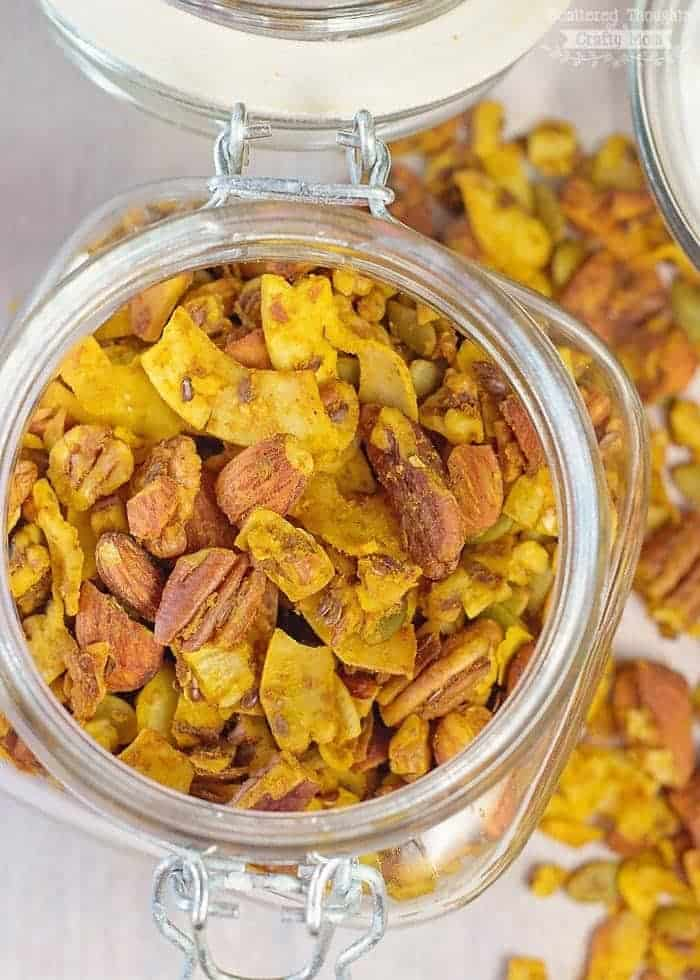 Pumpkin puree, dried unsweetened coconut flakes and nuts are combined with pumpkin pie spice in this deliciously healthy Sugar-Free Pumpkin Pie Granola Recipe!