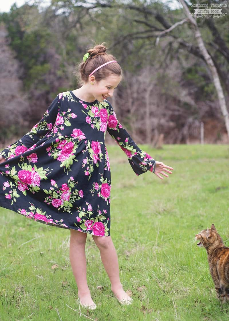 Free sewing pattern alert: Download a copy of this Bell Sleeve T-Shirt Dress! The free pdf pattern comes in girls sizes 3 to 12 and makes the perfect addition to any little girls wardrobe.