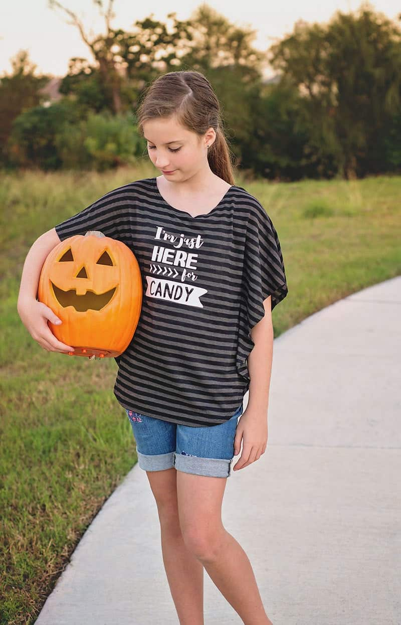 "Grab this free ""I'm Just Here For The Candy"" SVG and PDF file to make your own Halloween themed t-shirt, printable or Trick or Treat bag!"