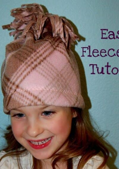 Keep the kid's ears toasty warm andlearn how to make an easy fleece hat with this super easy Fleece Hat Tutorial!