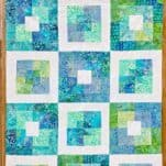 Learn how to make an easy square in square quilt block from a jelly roll! This Seaside Squares quilt pattern is put together completely with squarein square quilt blocks. Even better? I used a precut jellyroll to make the blocks! This project comes together very quickly and is a great next step project for a beginner quilter.