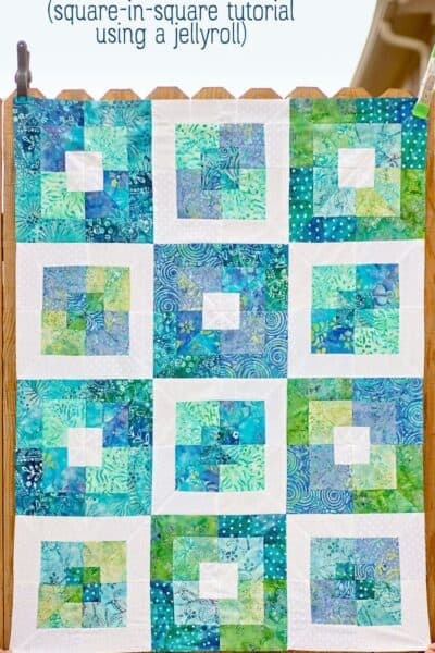 Learn how to make an easy square in square quilt block from a jelly roll!  This Seaside Squares quilt pattern is put together completely with square in square quilt blocks. Even better? I used a precut jellyroll to make the blocks!  This project comes together very quickly and is a great next step project for a beginner quilter.