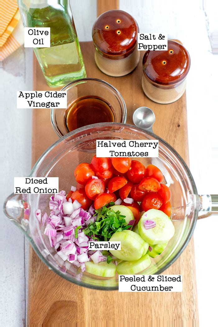 ingredients in a cucumber and tomato salad