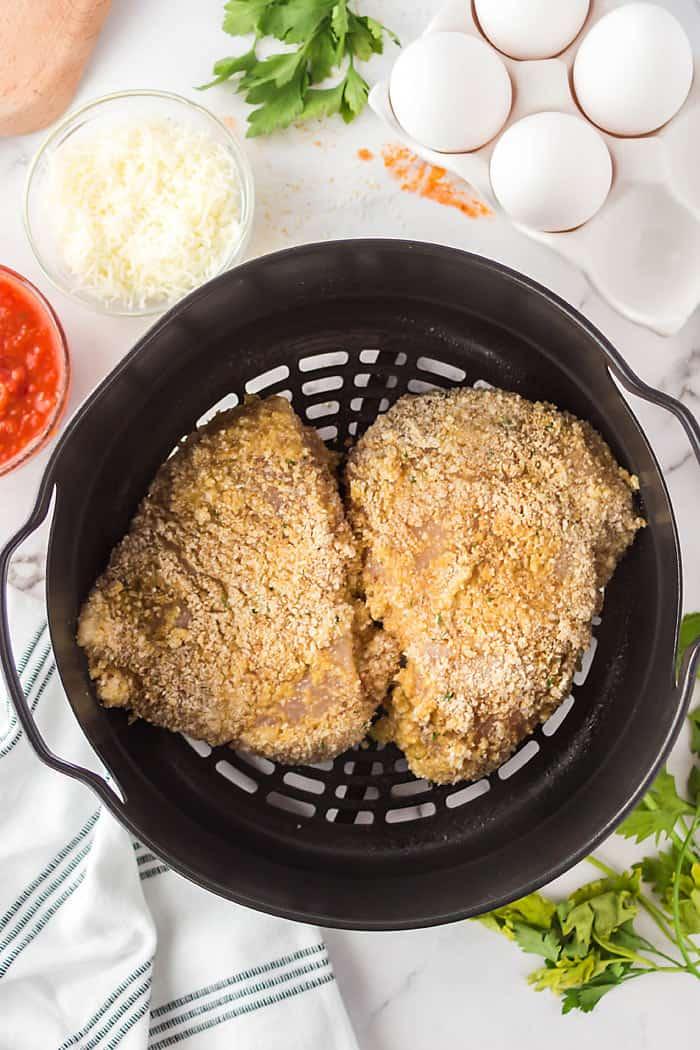 place breaded chicken parm in the airfryer