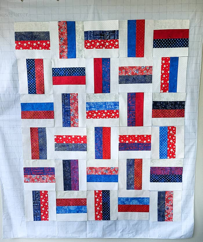 red white and blue quilt design wall