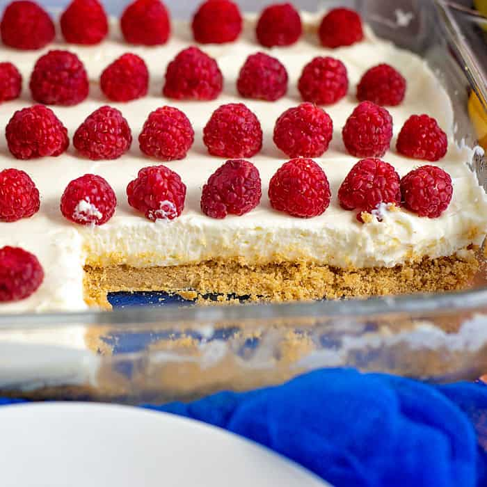 no bake cheesecake topped with raspberries